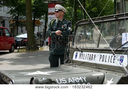 BERLIN - MAY 28: A man in the form of a military police car and Willys MB the exhibition
