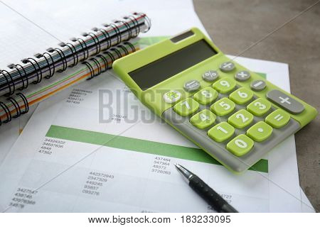 Calculator with bills on table. Tax concept