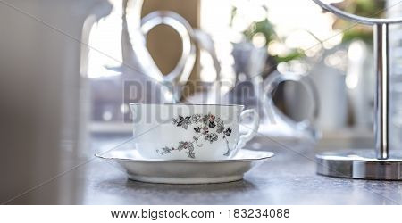 Closeup of china cup on table selective focus