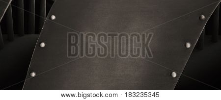 Grey metal with rivet background, black and white texture closeup