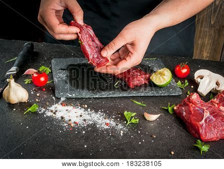 Woman Cooking Beef Meat