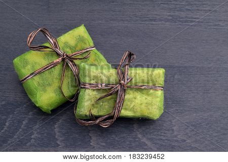 Small Green Gift Boxes With Brown Ribbon