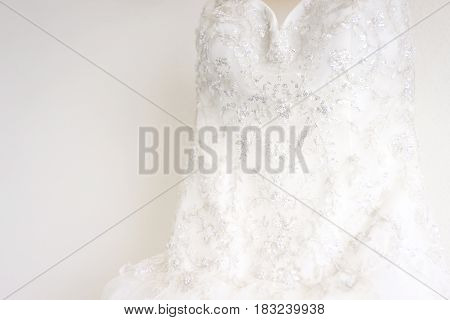 Bridal white decorated wedding dress in wedding day