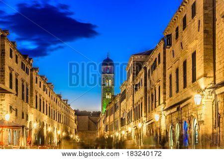 Night view at city life in town Dubrovnik, main street Stradun.