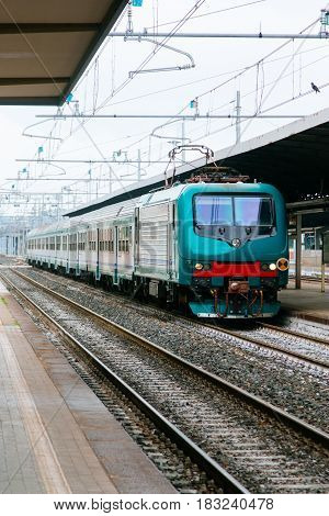 The Train Arrives At The Railway Station, Day, Daylight, Front View, Vertical Image, Space For Text.