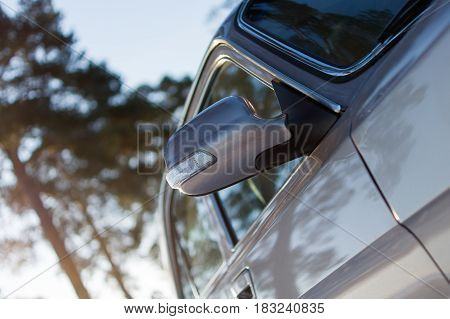 Close up view of rear view mirror of passenger car