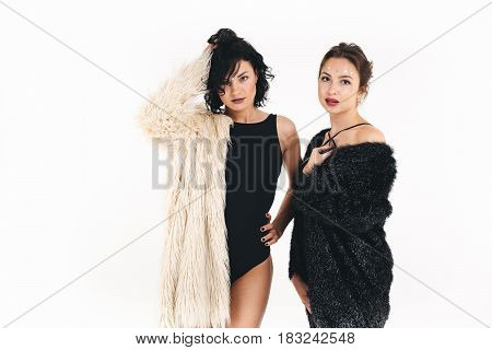 Full body portrait of young women, isolated over white background.