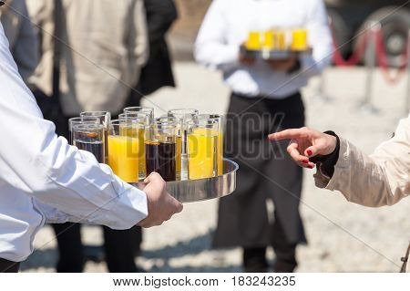Waiter serving soft drinks at a party