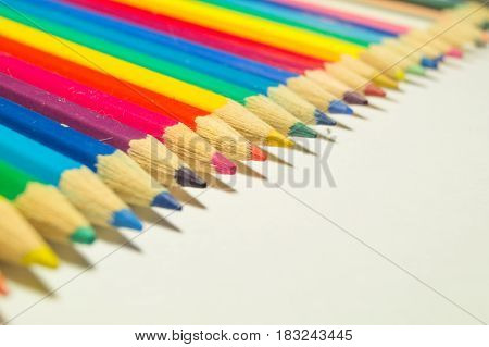 Colored pencils colors of rainbow on white background diagonal
