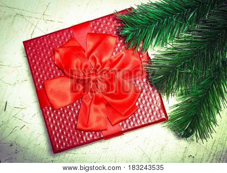 Red Gift, Present Box With A Beautiful Vibrant Red Ribbon And Some Christmas Decorations From A Flow