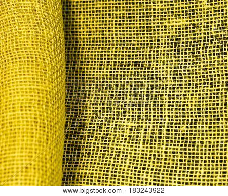 Yellow Jute, Floristic Net Rolled Up. On A Black Background
