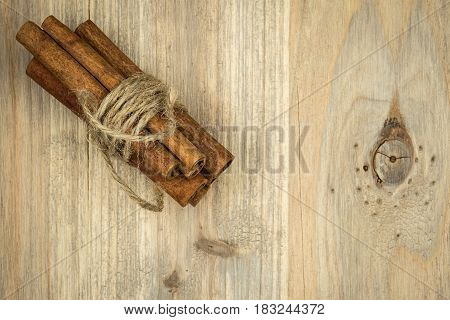Cinnamon Sticks On The Black Wooden Table. Fresh Cinnamon.