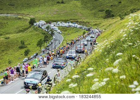 Col de PeyresourdeFrance- July 23 2014: Row of technical cars climbing the road to Col de Peyresourde in Pyrenees Mountains during the stage 17 of Le Tour de France on 23 July 2014.