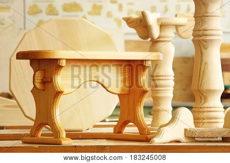Beautiful wooden bench on a wood background