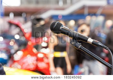 Microphone in focus, against blurred background. Public relation. Presentation.