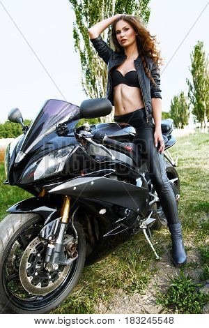 Sexual Biker Woman Wearing Black Leather Jacket With Her Sport Motorcycle On A Highway. Beauty, Fash