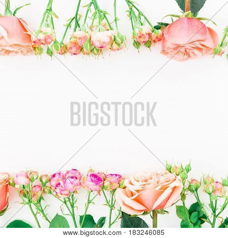 Frame made of pink peony roses and buds on white background. Flat lay, top view.