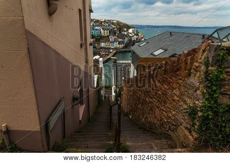 Descent on the stone stairs from the hill in the seacoast in the background panoramic view of the city colorful facades of buildings landscape