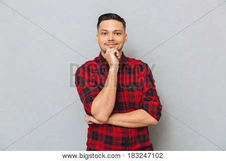 Asian thoughtful man wearing casual looking camera isolated