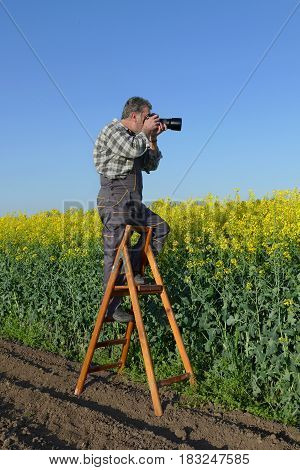 Photographer In Canola Field