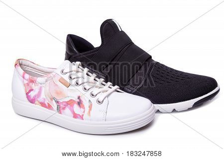 Mens Black And Womens White Sport Shoes. Isolate On White.