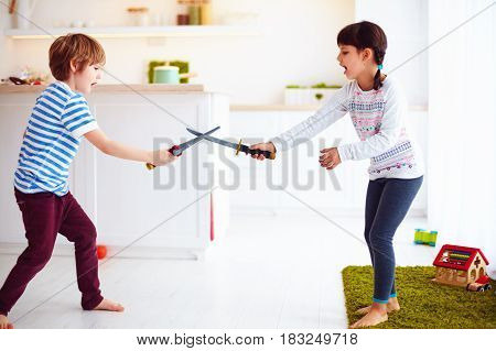 Kids Playing Active Fight Games At Home Kitchen