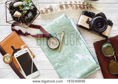 Wanderlust And Travel Concept. Compass And Pencil On Map Exploring. Passport Money Glasses Photo Cam