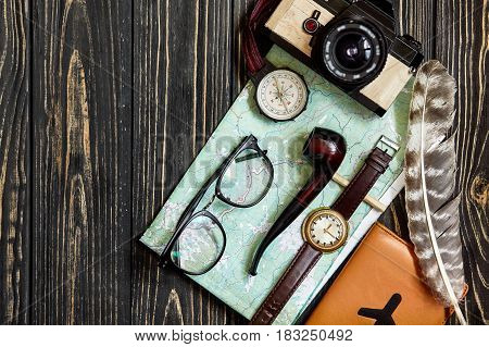 Wanderlust And Travel Concept, Hipster Flat Lay. Map Passport Compass And Glasses Photo Camera Pipe
