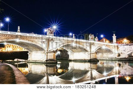 Sant' Angelo Bridge at night beautiful old sculptures and lanternsRome Italy.