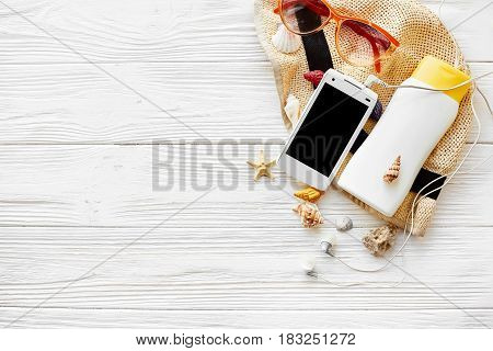 Summer Vacation Concept Flat Lay. Hat Phone With Empty Screen, Headphones Sunscreen Sunglasses And S