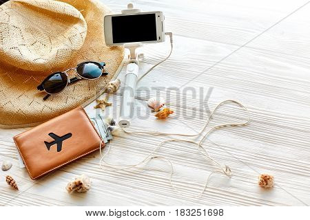 Summer Travel Vacation Concept, Space For Text. Selfie Stick Phone Camera Passport Money Plane Hat A
