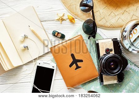 Time To Travel Concept And Wanderlust, Space For Text. Map Camera Passport Money Phone With Empty Sc