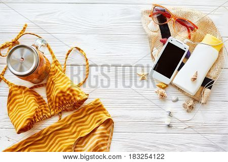 Summer Vacation Concept Flat Lay. Swimsuit Cocktail Hat Phone Headphones Suncream Sunglasses And She