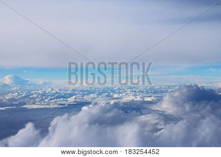 Clouds seen from the airplane and the sunshine nature background