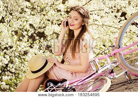 Conversation Time. Portrait Of Beautiful And Young Long-haired Girl In Pink Dress Talking The Phone