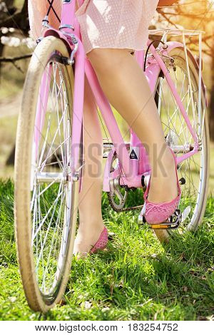 Retro Bike Concept. Closeup Of Tender Legs Of Beautiful And Young Girl Standing On Pedals Of Retro B
