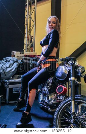 St. Petersburg Russia - 15 April, A fashion model on a motorcycle,15 April, 2017. International Motor Show IMIS-2017 in Expoforurum. Models on motorcycles presented at the motor show.