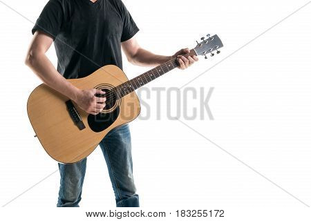 A Guitarist In Jeans And A Black T-shirt, Plays An Acoustic Guitar, On The Left Side Of The Frame, O