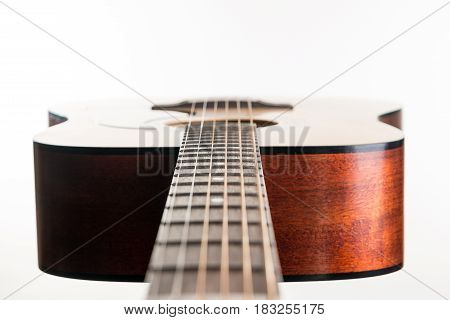 Acoustic Guitar Lies In A Frame On A White Isolated Background. Horizontal Frame