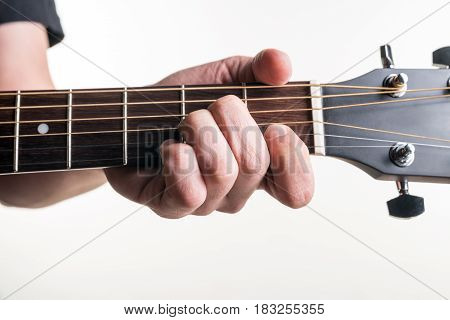 The Guitarist's Hand Clamps The Chord Am On The Guitar, On A White Background. Horizontal Frame