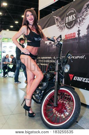 St. Petersburg Russia - 15 April, The girl at motobike,15 April, 2017. International Motor Show IMIS-2017 in Expoforurum. Models on motorcycles presented at the motor show.