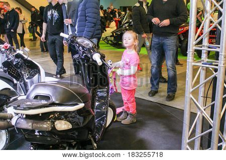 St. Petersburg Russia - 15 April, A small visitor at a motor depot,15 April, 2017. International Motor Show IMIS-2017 in Expoforurum. Visitors and participants of the annual moto-salon in St. Petersburg.