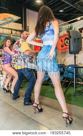 St. Petersburg Russia - 15 April, A number of dancing people,15 April, 2017. International Motor Show IMIS-2017 in Expoforurum. Erotic dances of the girls at the motor show.