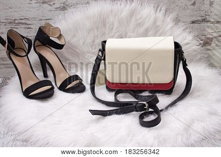 White and red women's bag black shoes with white fur. Fashionable concept