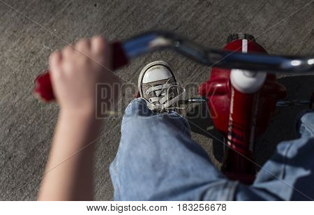 Tricycle ride, red, bike, converse shoe, toddler