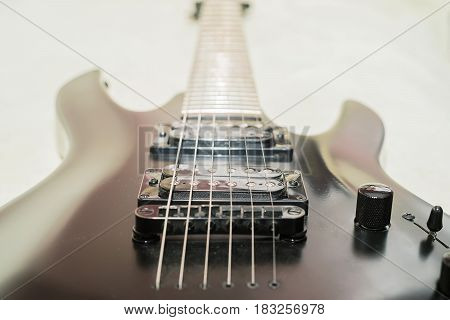 Closeup image of modern rock electric guitar