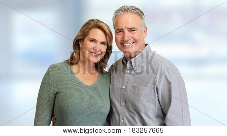 Senior couple smiling.