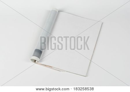 Mock-up magazine or catalog on white table. Blank page or notepad on neutral background. Blank page or notepad for mockups or simulations.