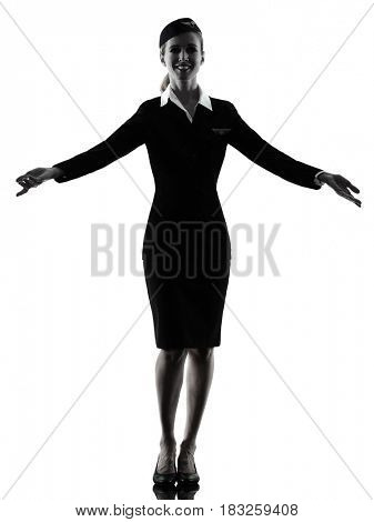 one caucasian Stewardess cabin crew  woman welcoming isolated on white background in  silhouette