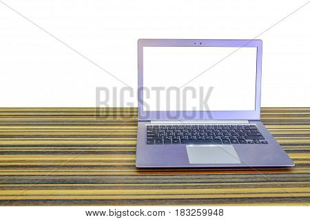 Laptop with blank screen on long table with isolated on white background